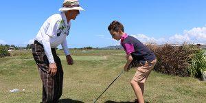 Charlie and Josh practise golf