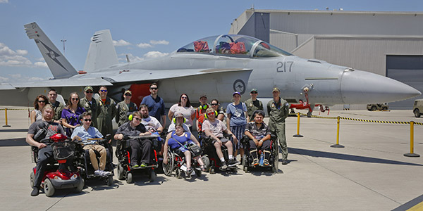 Lifestyle participants with a F/A-18F Super Hornet.