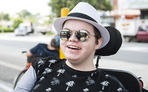 Young man in sunglasses smiling