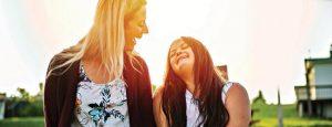 Two girls laughing