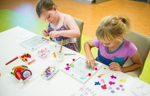 Two girls doing a craft activity
