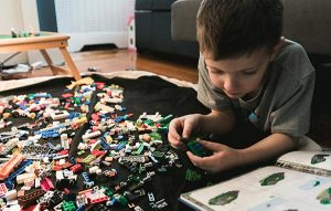 Boy playing lego