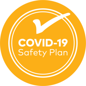 Logo with a tick that says COVID 19 safety plan