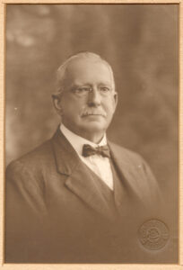 A black and white photo of Mr George Marchant